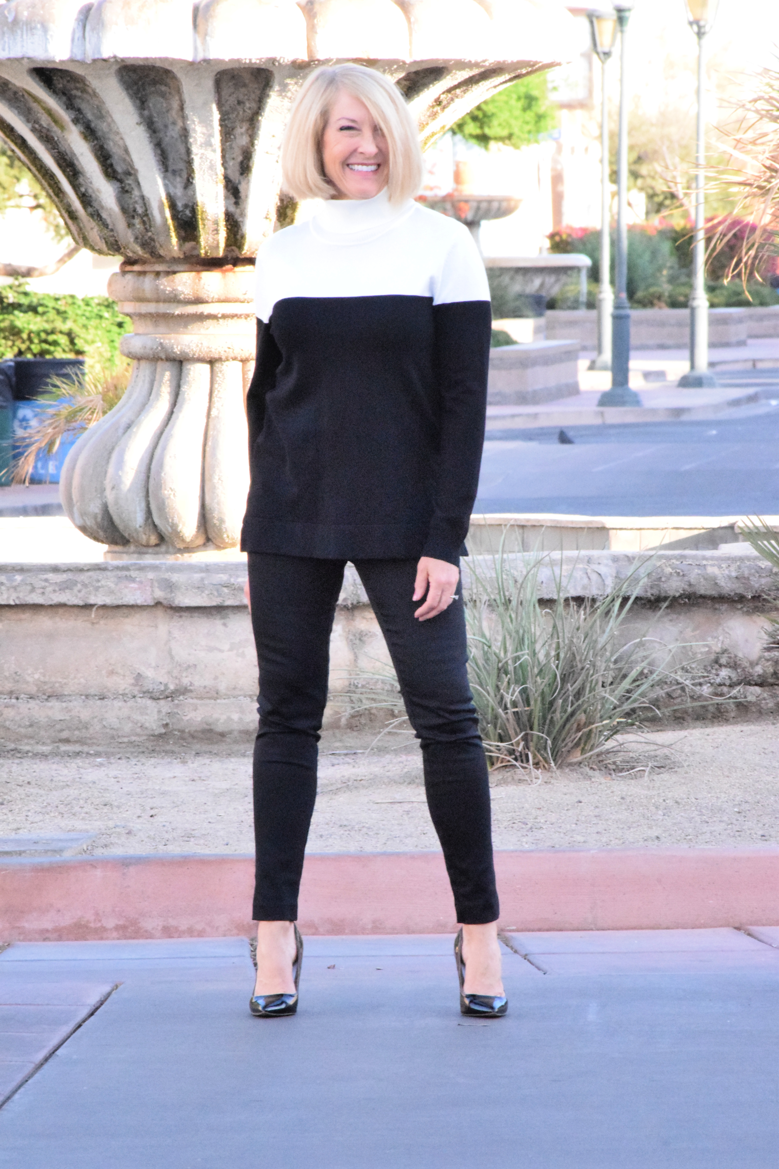 Chic and comfy Calvin Klein colorblock sweater in black and white.